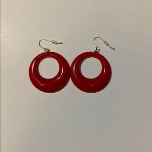 red plastic earrings